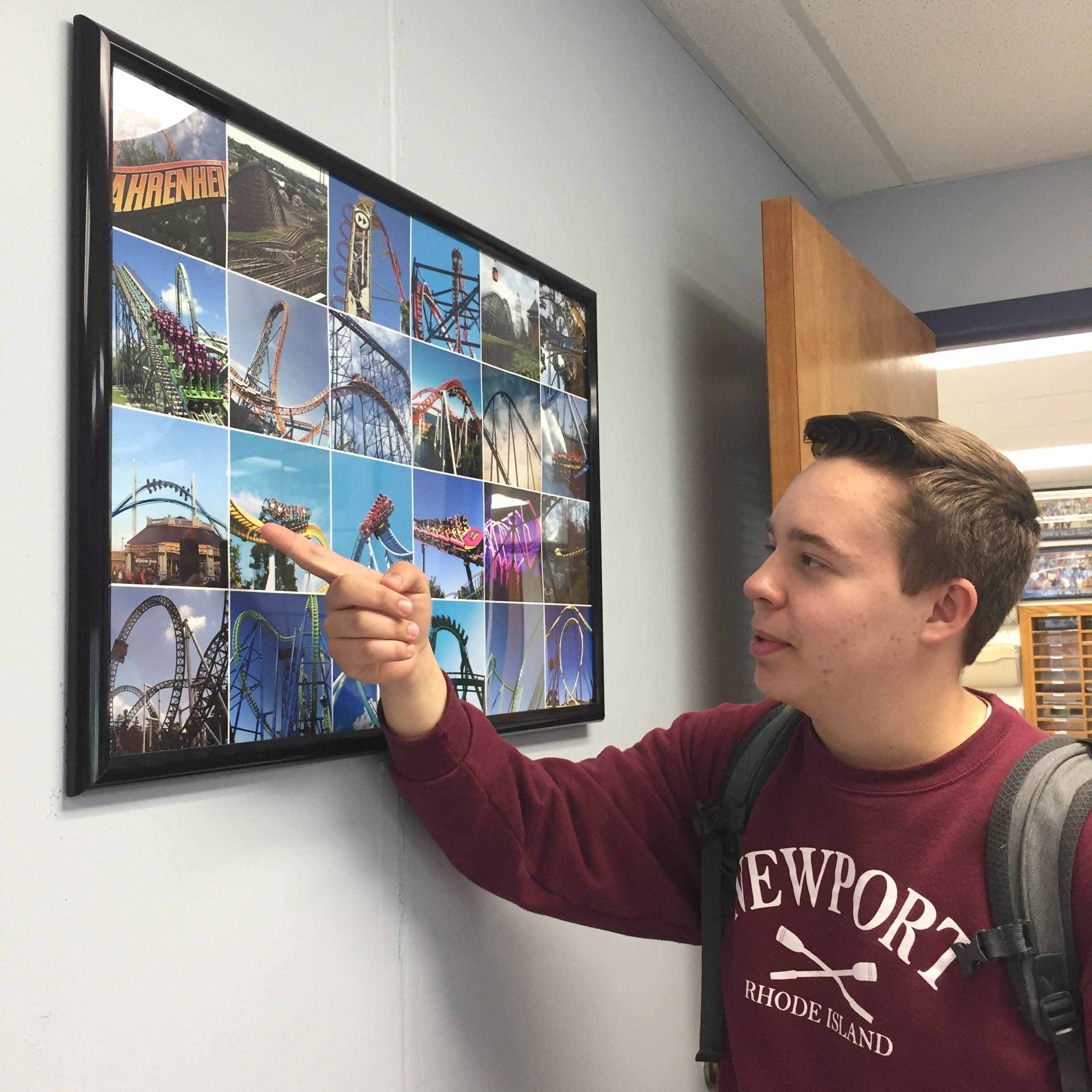 Senior Charlie Rau, 18, discusses roller coasters in front of a picture collage of his favorite rides.