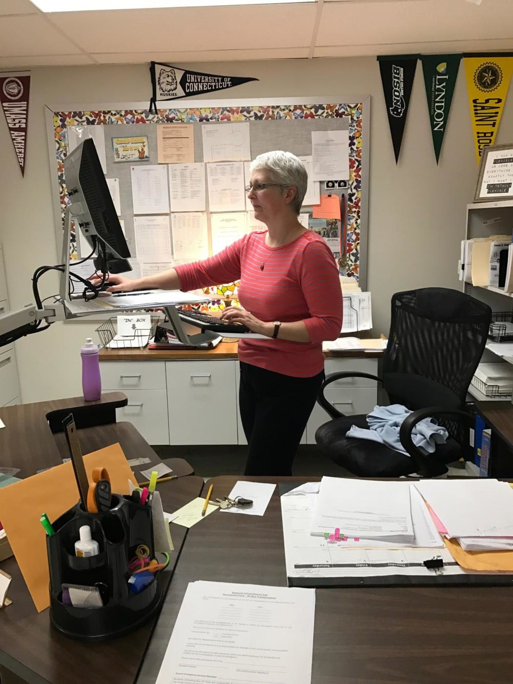 Guidance department secretary Cindy Berardinelli recently started using a standing desk, and touts benefits of her new perspective on work.