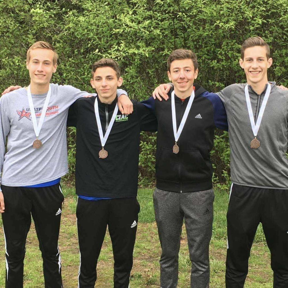 Senior+Nick+O%27Brien%2C+second+from+right%2C+poses+with+members+of+the+Mills+4X800+relay+team.+Contributed+photo