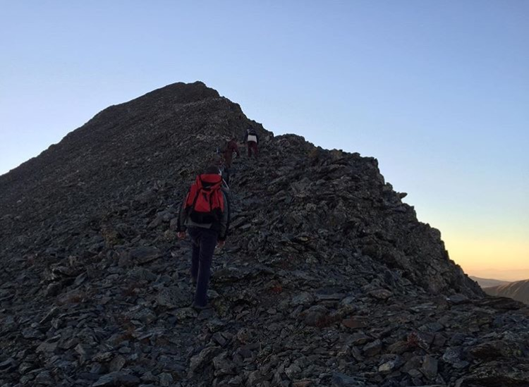 Trevor+Serrano+makes+an+early+morning+14%2C200-foot+summit+in+Colorado+in+September+2015.+The+local+22-year-olds+latest+travels+will+have+him+hiking+the+Appalachian+Trail+over+the+next+five+to+seven+months.++Contributed+photo