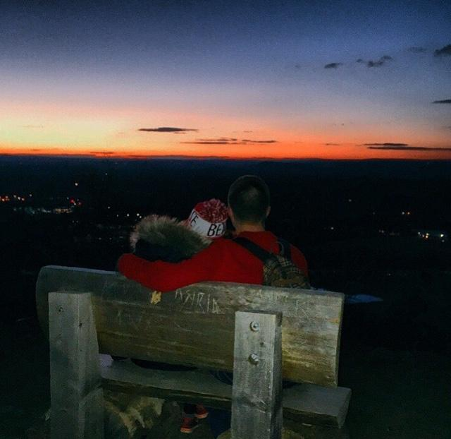 Rachel Lord and Jake Wall enjoy the sunset vista at Talcott Mountain.  Taking a hike, allowing daters to talk and get some fresh air, embodies a perfect first date, unlike the cliched movie theater date that prevents couples from interacting.   Photo Courtesy of: Instagram