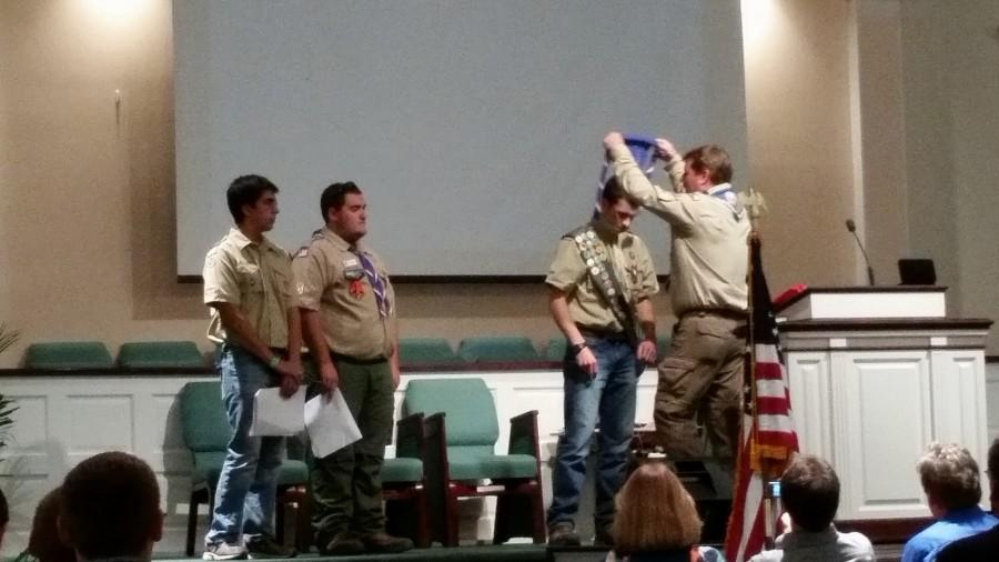 Justin receiving his Eagle Scout Neckerchief from Scout Master and Eagle Scout Scott Melancon.
