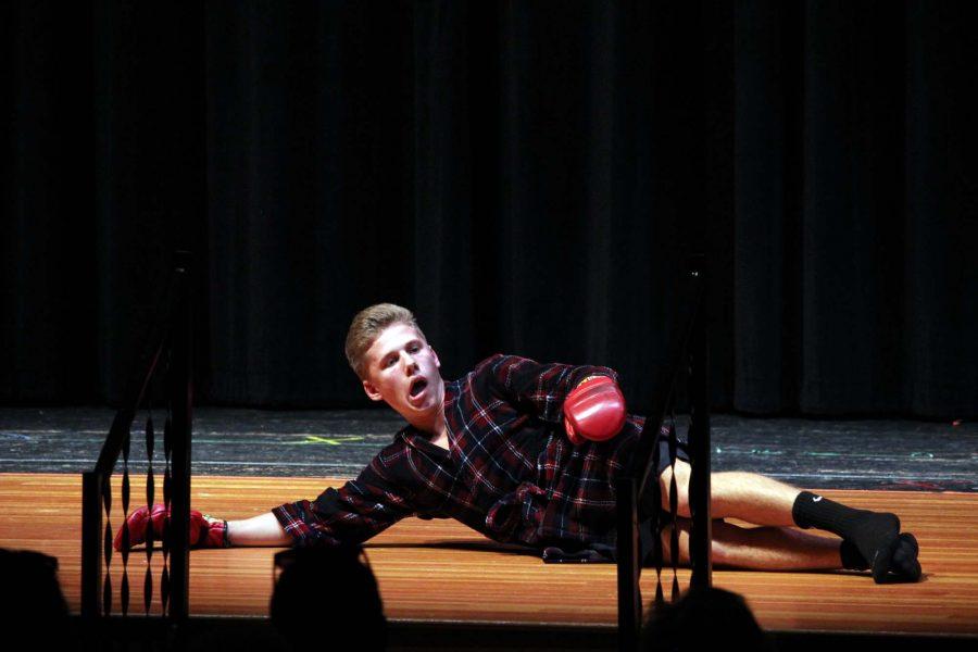 Senior Jacob Honig improvises to demonstrate a scene from