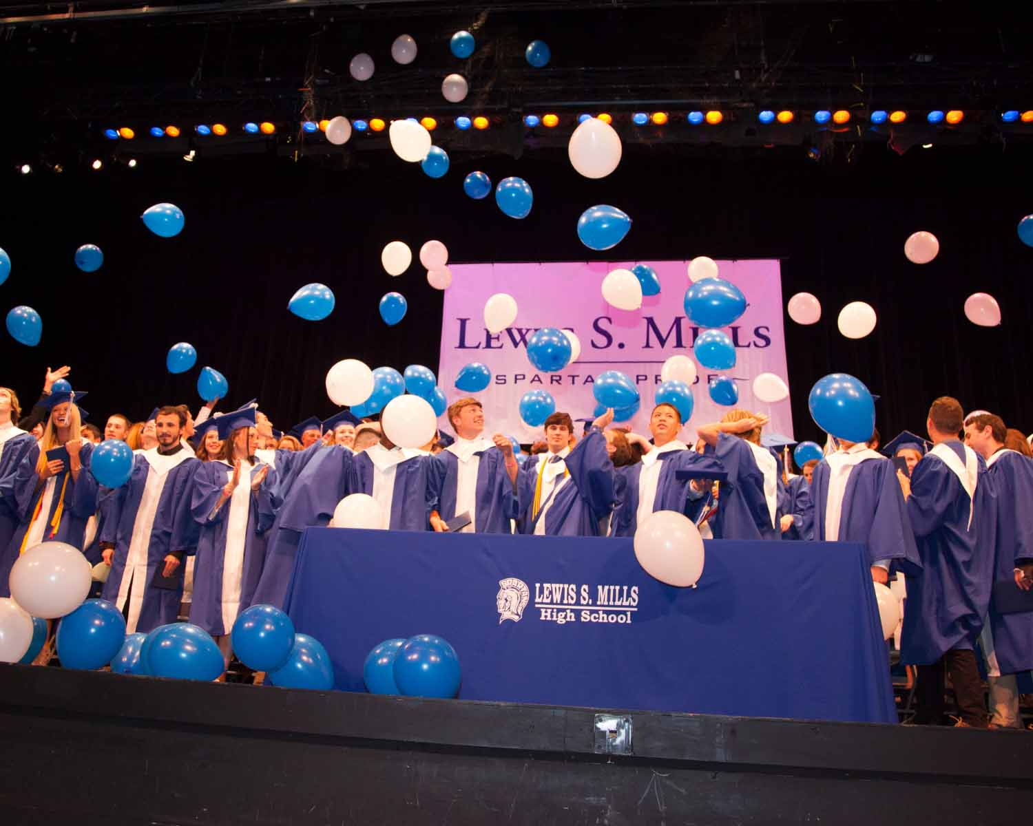 Students at the 2016 graduation wore blue gowns, marking the second or third year of a more gender-neutral approach to graduation garb at Mills. School officials and students revisited graduation gown colors this spring before deciding to maintain the all-blue gowns for seniors this June.