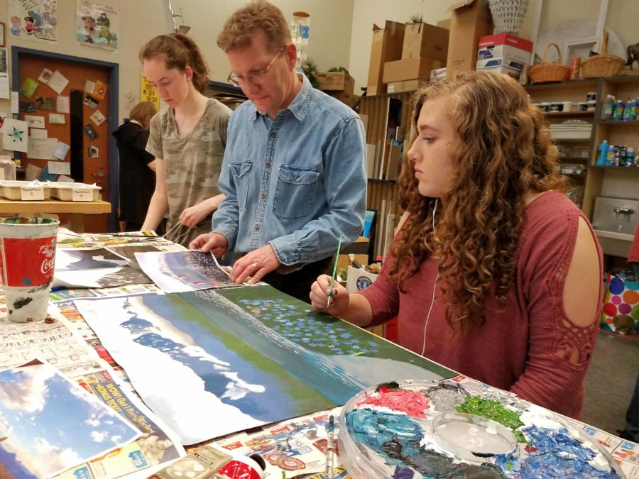 Substitute teacher Todd Russo helps students during a late April art class at Mills. Russo would like the chance to speak to students at graduation festivities in June.
