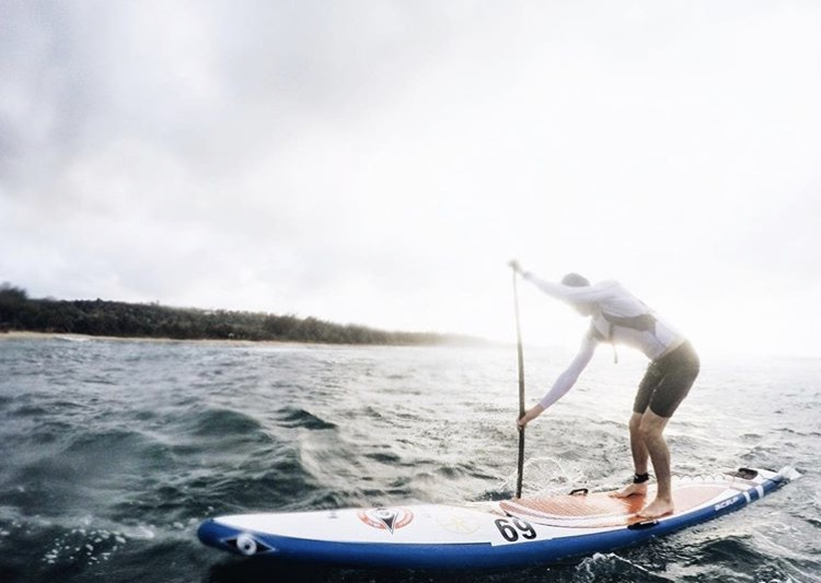Stand-up paddleboarding takes senior Jack Martin across the country and beyond to compete. Contributed photo