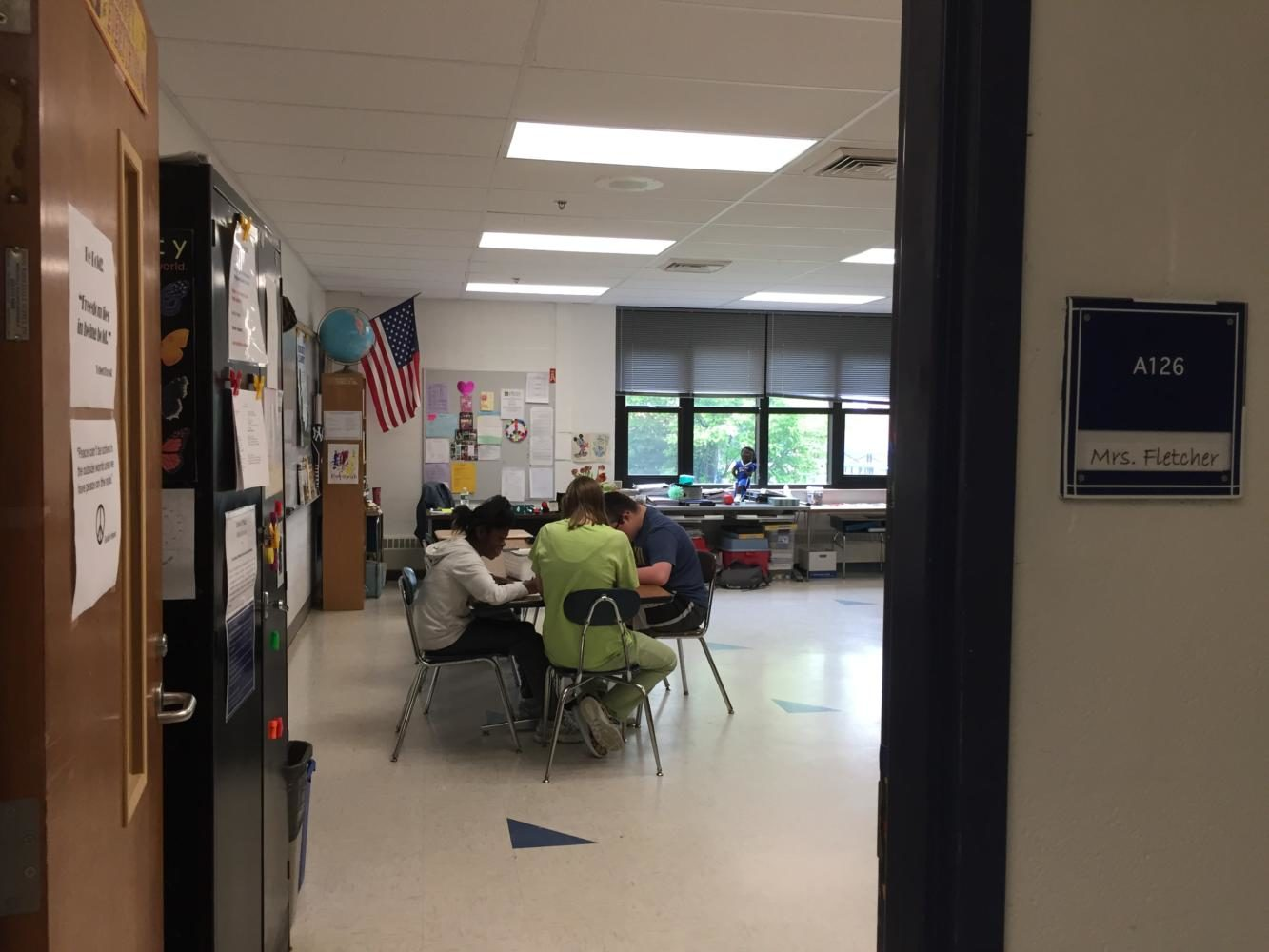 Senior+Mariel+Hayes%2C+center%2C+talks+with+students+in+the+STARS+room+on+a+recent+June+day.
