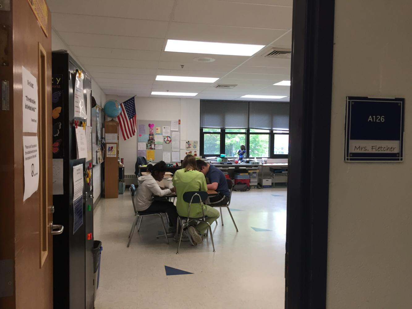 Senior Mariel Hayes, center, talks with students in the STARS room on a recent June day.