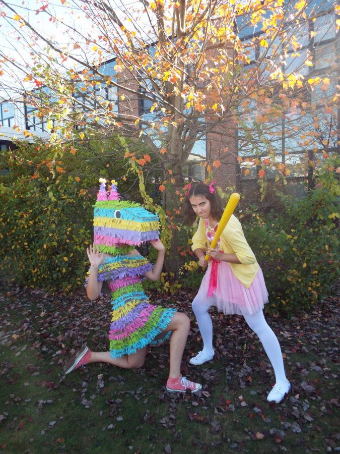 Erin Gonchar and Hannah Chadwick pose as a kid and piñata