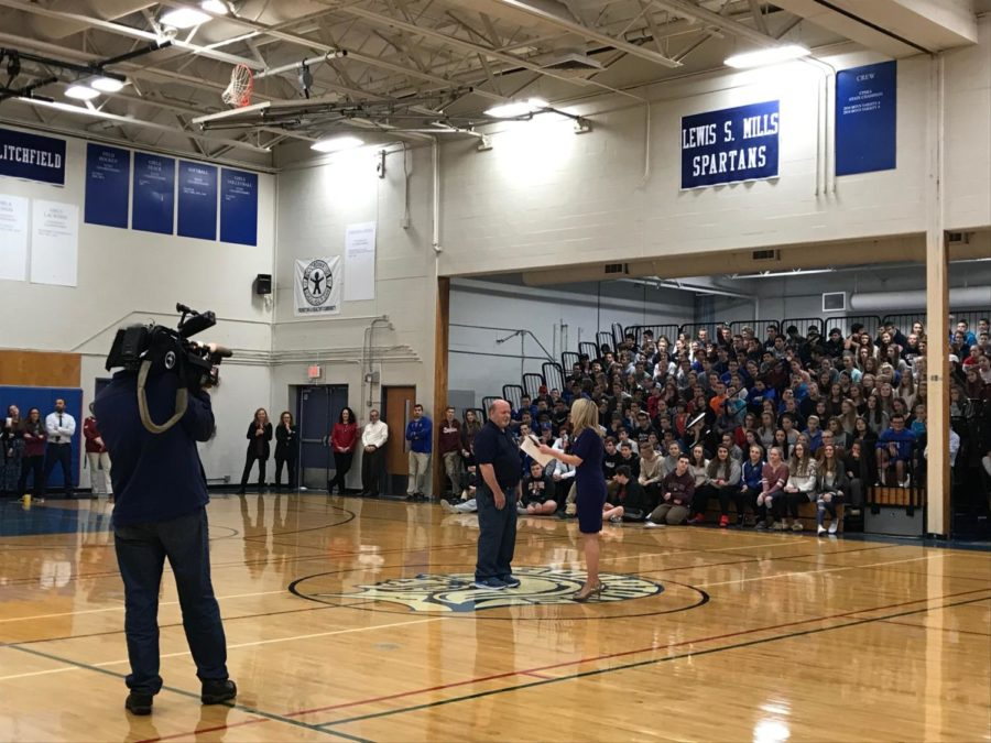 LSM custodian Lowell Wortman listened to a WFSB Channel 3 Surprise Squad member as his special selection for an honor and prizes - including UConn Lady Husky tickets - was announced last week.
