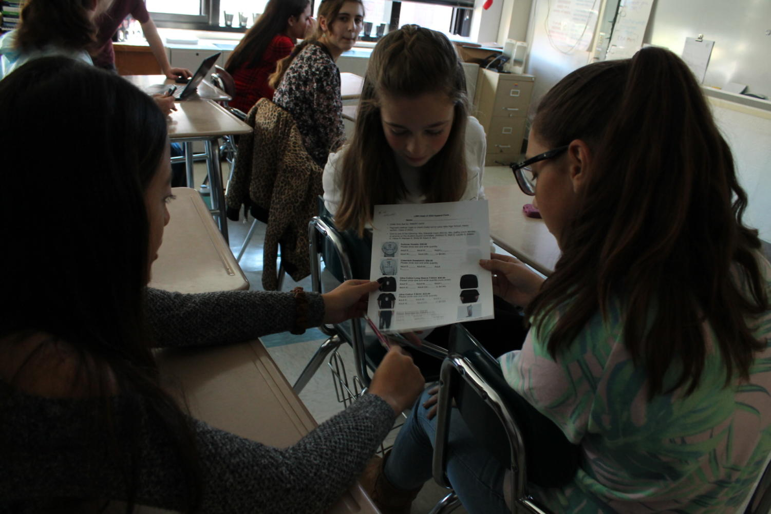 Freshmen students interested in being a part of their class leadership look over a Class of 2022 fundraising sheet. This is the second year of a freshman leadership group intended to groom and prepare students to serve in and with class officers.