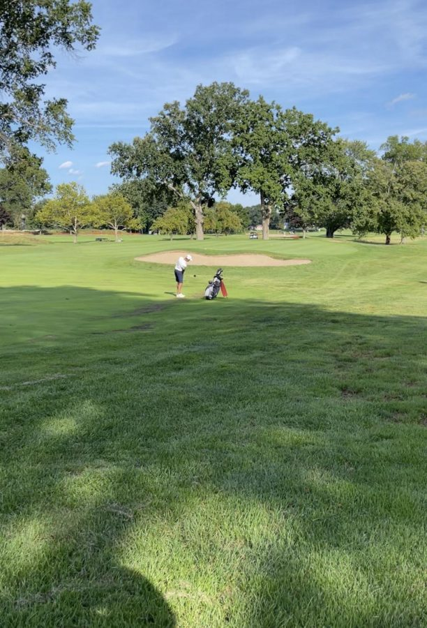 James Bolleyer taking a swing towards the green.